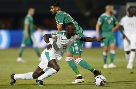 In this Thursday, June 27, 2019 photo, Senegal's Sadio Mane in action in front of Algeria's Riyad Mahrez during the African Cup of Nations group C soccer match between Algeria and Senegal at 30 June Stadium in Cairo, Egypt, Thursday, June 27, 2019. (AP Photo/Ariel Schalit)