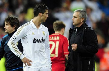Real Madrid's Portuguese coach Jose Mourinho (R) talks to Real Madrid's Portuguese forward Cristiano Ronaldo during the UEFA Champions League second leg semi-final football match Real Madrid against Bayern Munich at the Santiago Bernabeu stadium in Madrid on April 25, 2012. Bayern Munich reached the Champions League final beating nine-time champions Real Madrid 3-1 on penalties after the two-legged match finished 3-3 on aggregate. Bastian Schweinsteiger slotted home the winning penalty in a thrilling shootout which saw Bayern lead 2-0 at one point after Cristiano Ronaldo and Kaka missed theirs for Real.  AFP PHOTO / JAVIER SORIANOJAVIER SORIANO/AFP/GettyImages