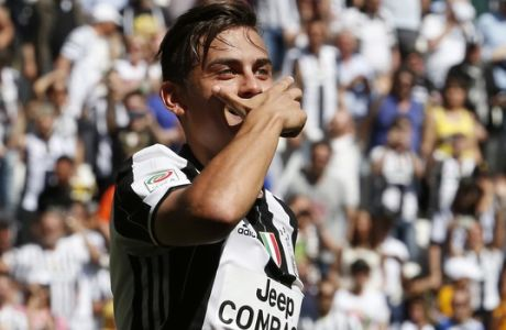 Juventus' Paulo Dybala celebrates after scoring during the Serie A soccer match between Juventus and Crotone at the Juventus stadium, in Turin, Italy, Sunday, May 21, 2017. (AP Photo/Antonio Calanni)