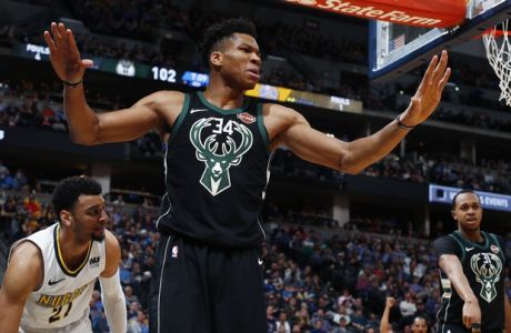 Milwaukee Bucks forward Giannis Antetokounmpo reacts after being called for a foul on Denver Nuggets guard Jamal Murray during the second half of an NBA basketball game Sunday, April 1, 2018, in Denver. The Nuggets won 128-125 in overtime. (AP Photo/David Zalubowski)