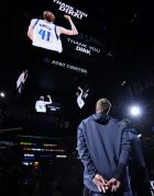 Dallas Mavericks' Dirk Nowitzki watches a video tribute to him from the San Antonio Spurs before an NBA basketball game Wednesday, April 10, 2019, in San Antonio. (AP Photo/Darren Abate)