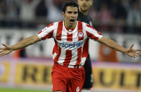 Olympiakos' Javier Saviola from Argentina celebrates after scoring the second goal of his team against PAOK during their Greek League soccer match in the port of Piraeus, near Athens, Sunday, Nov. 10, 2013. (AP Photo/Thanassis Stavrakis)