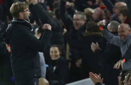 Liverpool coach Juergen Klopp celebrates as his team scores during the Champions League quarter final first leg soccer match between Liverpool and Manchester City at Anfield stadium in Liverpool, England, Wednesday, April 4, 2018. (AP Photo/Dave Thompson)