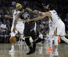 Golden State Warriors' DeMarcus Cousins (0) is fouled by Utah Jazz guard Ricky Rubio, right, during the second half of an NBA basketball game Tuesday, Feb. 12, 2019, in Oakland, Calif. (AP Photo/Ben Margot)