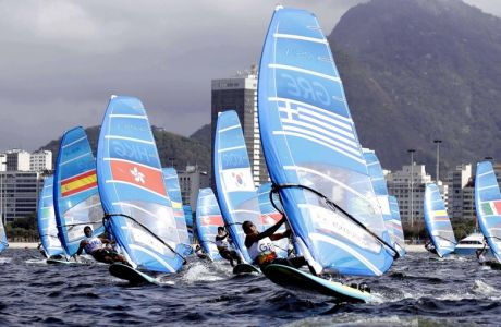 Athletes of the RS:X men event start their race during the 2016 Summer Olympics in Rio de Janeiro, Brazil, Monday, Aug. 8, 2016. (AP Photo/Gregorio Borgia)