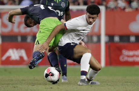 Liverpool FC's Curtis Jones, right, fights for control with Sporting CP's Eduardo Quaresma during the second half of a soccer match Wednesday, July 24, 2019, in New York. The game ended 2-2. (AP Photo/Frank Franklin II)