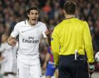 PSG's Edinson Cavani argues with the fourth referee during the Champion's League round of 16, second leg soccer match between FC Barcelona and Paris Saint Germain at the Camp Nou stadium in Barcelona, Spain, Wednesday March 8, 2017. (AP Photo/Emilio Morenatti)