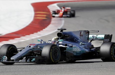 Mercedes driver Lewis Hamilton, of Britain, comes through a turn during the Formula One U.S. Grand Prix auto race at the Circuit of the Americas, Sunday, Oct. 22, 2017, in Austin, Texas. (AP Photo/Darron Cummings)