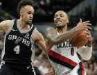 Portland Trail Blazers' Damian Lillard (0) drives around San Antonio Spurs' Derrick White during the second half of an NBA basketball game, Sunday, Dec. 2, 2018, in San Antonio. San Antonio won 131-118. (AP Photo/Darren Abate)