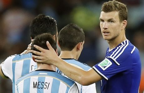 Argentina's Lionel Messi, left, and Bosnia's Edin Dzeko greet each other after the group F World Cup soccer match between Argentina and Bosnia at the Maracana Stadium in Rio de Janeiro, Brazil, Sunday, June 15, 2014.  Argentina won the match 2-1. (AP Photo/Victor R. Caivano)
