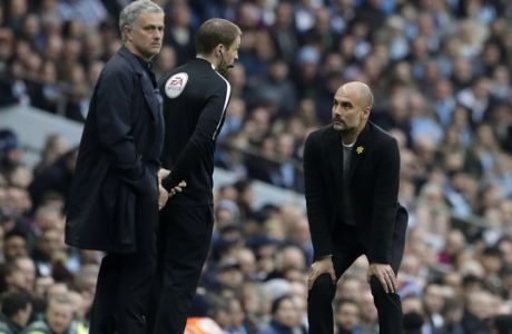 Manchester City coach Pep Guardiola, right, and Manchester United manager Jose Mourinho, left, on the sideline during the English Premier League soccer match between Manchester City and Manchester United at the Etihad Stadium in Manchester, England, Saturday April 7, 2018. (AP Photo/Matt Dunham)