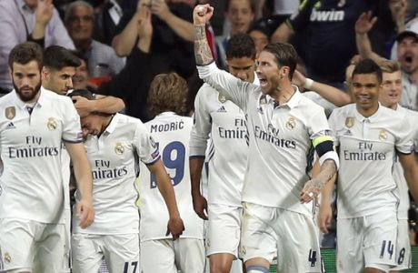 Real Madrid players celebrate after scoring their third goal during the Champions League semifinals first leg soccer match between Real Madrid and Atletico Madrid at Santiago Bernabeu stadium in Madrid, Spain, Tuesday May 2, 2017. (AP Photo/Daniel Ochoa de Olza)