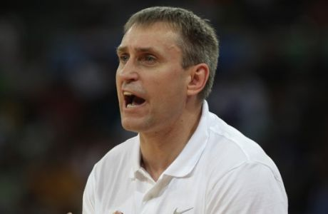 Lithuania's coach Kestutis Kemzura gestures during a semifinal basketball game against Dominican Republic of the Olympic qualifier in Caracas, Venezuela, Saturday, July 7, 2012. (AP Photo/Fernando Llano)