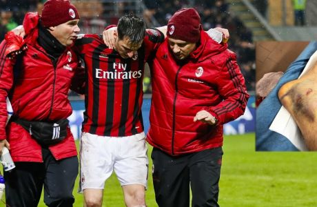 AC Milan's Nikola Kalinic, center is helped out of the field after he injured himself during an Italian Cup quarter-final soccer match between Milan and Inter Milan at the San Siro stadium in Milan, Italy, Wednesday, Dec. 27, 2017. (AP Photo/Antonio Calanni)