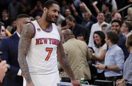 New York Knicks' Carmelo Anthony (7) leaves the court after an NBA basketball game against the Philadelphia 76ers Wednesday, April 12, 2017, in New York. The Knicks won 114-113. (AP Photo/Frank Franklin II)