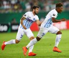 Football Soccer - Rapid Wien v Genk - UEFA Europa League Group Stage - Group F - Allianz Arena, Vienna, Austria - 15/9/16 Genk's Leon Bailey reacts after scoring a goal with teammate Alejandro Pozuelo REUTERS/Leonhard Foeger