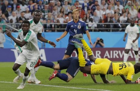 Senegal's Moussa Vague, left, runs for the ball during the group H match between Japan and Senegal at the 2018 soccer World Cup at the Yekaterinburg Arena in Yekaterinburg , Russia, Sunday, June 24, 2018. (AP Photo/Vadim Ghirda)