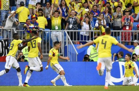 Colombian players celebrate the goal by teammate Yerry Mina, second left, during the group H match between Senegal and Colombia, at the 2018 soccer World Cup in the Samara Arena in Samara, Russia, Thursday, June 28, 2018. (AP Photo/Martin Meissner)