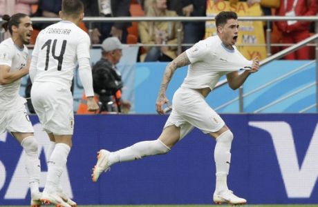 Uruguay's Jose Gimenez, right, celebrates after scoring his side's opening goal during the group A match between Egypt and Uruguay at the 2018 soccer World Cup in the Yekaterinburg Arena in Yekaterinburg, Russia, Friday, June 15, 2018. (AP Photo/Mark Baker)