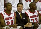 Louisville coach Rick Pitino is flanked by senior players Reece Gaines, left, and Eric Brown as they wait for a team picture during media day at the school Thursday, Oct. 10, 2002, in Louisville, Ky.  (AP Photo/Ed Reinke)
