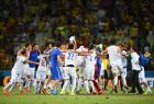 FORTALEZA, BRAZIL - JUNE 24:  Greece celebrate after defeating the Ivory Coast 2-1 during the 2014 FIFA World Cup Brazil Group C match between Greece and the Ivory Coast at Castelao on June 24, 2014 in Fortaleza, Brazil.  (Photo by Laurence Griffiths/Getty Images)