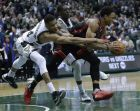 Milwaukee Bucks' Giannis Antetokounmpo fouls Toronto Raptors' DeMar DeRozan during the second half of Game 6 of an NBA first-round playoff series basketball game Thursday, April 27, 2017, in Milwaukee. The Raptors won 92-89 to win the series. (AP Photo/Morry Gash)
