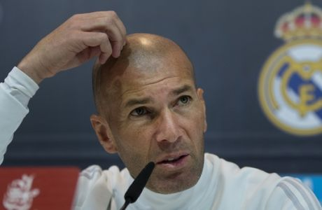 Real Madrid's head coach Zinedine Zidane speaks during a press conference in Madrid, Spain, Friday, Jan. 26, 2018. Real Madrid meet Valencia Saturday in a league soccer match after being knocked out of the Copa del Rey competition by Leganes last Wednesday. (AP Photo/Paul White)