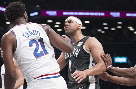 Brooklyn Nets forward Jared Dudley (6) confronts Philadelphia 76ers center Joel Embiid (21) after Embiid fouled center Jarrett Allen during the second half of Game 4 of a first-round NBA basketball playoff series, Saturday, April 20, 2019, in New York. The 76ers won 112-108. (AP Photo/Mary Altaffer)