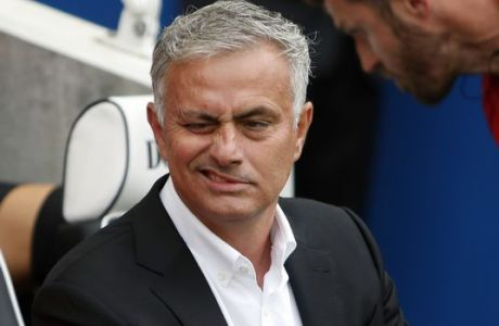Manchester United's manager Jose Mourinho grimaces as he takes his seat for the English Premier League soccer match between Brighton and Hove Albion and Manchester United at the Amex stadium in Brighton, England, Sunday, Aug. 19, 2018. (AP Photo/Alastair Grant)