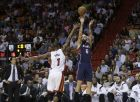 Atlanta Hawks forward Pero Antic (6) of Macedonia attempts a three point basket against Miami Heat center Chris Bosh (1) in the first half of an NBA basketball game, Wednesday, Dec. 3,  2014, in Miami. (AP Photo/Lynne Sladky)