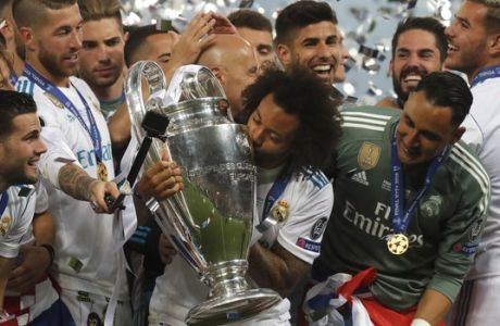 Real Madrid's Marcelo kisses the trophy after winning the Champions League Final soccer match between Real Madrid and Liverpool at the Olimpiyskiy Stadium in Kiev, Ukraine, Saturday, May 26, 2018. (AP Photo/Efrem Lukatsky)