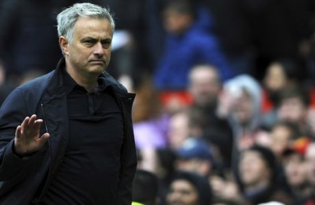 Manchester United manager Jose Mourinho walks on the pitch at the end of the English Premier League soccer match between Manchester United and Arsenal at the Old Trafford stadium in Manchester, England, Sunday, April 29, 2018. (AP Photo/Rui Vieira)