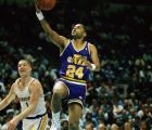Utah Jazz guard Jeff Malone (24) drives by Golden State Warriors forward Chris Mullin on his way to the hoop for an easy bucket during first quarter in Oakland, California December 4, 1991. The warriors went on to bet the Jazz 108-103. (AP Photo/Brad Mangin)