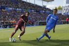 "Barcelona's Ousmane Dembele, left, with Getafe's Juan Torres Ruiz ""Cala"" during a Spanish La Liga soccer match between Getafe and Barcelona at the Alfonso Perez stadium in Getafe, outside Madrid, Saturday, Sept. 16, 2017. Barcelona won 2-1. (AP Photo/Francisco Seco)"