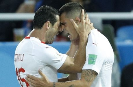 Switzerland's Granit Xhaka, right, celebrates with teammate Blerim Dzemaili after scoring his side's opening goal during the group E match between Switzerland and Serbia at the 2018 soccer World Cup in the Kaliningrad Stadium in Kaliningrad, Russia, Friday, June 22, 2018. (AP Photo/Victor Caivano)