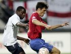 England's soccer player Nedum Onuoha, left, and Djordje Rakicof the Serbia battle for the ball during their first round group B UEFA U21 Championship soccer match between England and Serbia at the Goffert stadium in Nijmegen, The Netherlands, Sunday June 17, 2007. (AP Photo/Bas Czerwinski)