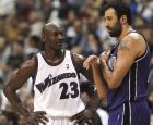 Washington Wizards' Michael Jordan (23) shares a moment with Sacramento Kings Vlade Divac of Serbia-Montenegro, right during the second half of the Kings' 105-99 win, Wednesday, April 2, 2003, in Washington.(AP Photo/Nick Wass)