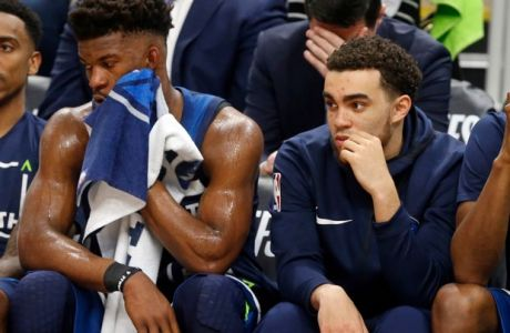 Minnesota Timberwolves players, from left, Jimmy Butler, Tyus Jones, Andrew Wiggins and Karl-Anthony Towns sit it out in final couple minutes during the second half of Game 4 in an NBA basketball first-round playoff series Monday, April 23, 2018, in Minneapolis. The Rockets won 119-100, and lead the series 3-1. (AP Photo/Jim Mone)