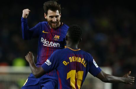 FC Barcelona's Lionel Messi celebrates with his teammate Dembele after scoring during the Spanish La Liga soccer match between FC Barcelona and Girona at the Camp Nou stadium in Barcelona, Spain, Saturday, Feb. 24, 2018. (AP Photo/Manu Fernandez)