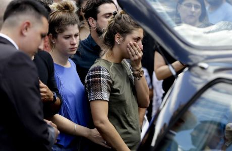 Romina Sala, the sister Argentine soccer player Emiliano Sala, cries at the end of her brother's wake in Progreso, Argentina, Saturday, Feb. 16, 2019. The Argentina-born forward died in an airplane crash in the English Channel last month when flying from Nantes in France to start his new career with English Premier League club Cardiff. (AP Photo/Natacha Pisarenko)