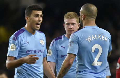 Manchester City's Rodrigo, left, Manchester City's Kevin De Bruyne, centre, and Manchester City's Kyle Walker during the English Premier League soccer match between Manchester City and Manchester United at Etihad stadium in Manchester, England, Saturday, Dec. 7, 2019. (AP Photo/Rui Vieira)