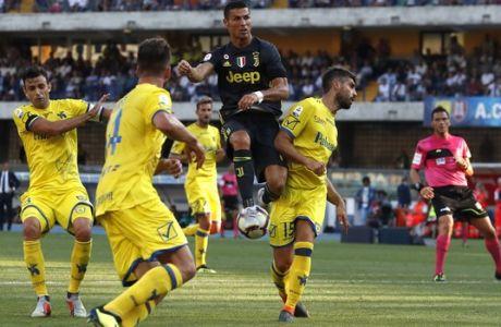 Juventus' Cristiano Ronaldo jumps as he reaches for the ball during the Serie A soccer match between Chievo Verona and Juventus, at the Bentegodi Stadium in Verona, Italy, Saturday, Aug. 18, 2018. (AP Photo/Antonio Calanni)