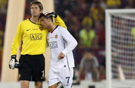 Manchester United's Edwin van der Sar, left, and Cristiano Ronaldo react at the end of the UEFA Champions League final soccer match between Manchester United and Barcelona in Rome, Wednesday May 27, 2009. Barcelona won 2-0. (AP Photo/Jon Super)