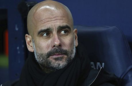 Manchester City's manager Pep Guardiola ahead of the English League Cup semifinal first leg soccer match between Manchester City and Bristol City at the Etihad stadium in Manchester, England, Tuesday, Jan. 9, 2018. (AP Photo/Dave Thompson)