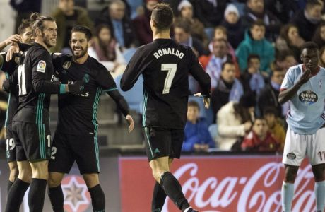 Real Madrid's Gareth Bale, left, is congratulated by teammates after scoring the second goal during a Spanish La Liga soccer match between RC Celta and Real Madrid at the Balaidos stadium in Vigo, Spain, Sunday, Jan. 7, 2018. (AP Photo/Lalo R. Villar)