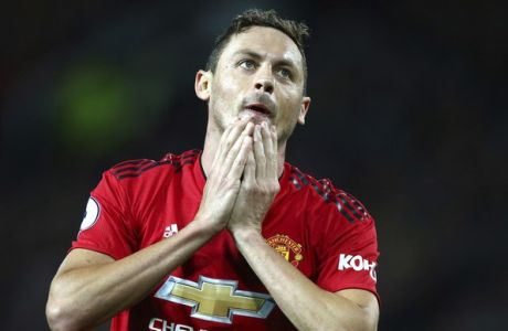 Manchester United's Nemanja Matic reacts after missing a chance during the English Premier League soccer match between Manchester United and Tottenham Hotspur at Old Trafford stadium in Manchester, England, Monday, Aug. 27, 2018. (AP Photo/Dave Thompson)