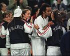 French Fed Cup team coach Yannick Noah, center,  gives a jubilant kiss to his team members after defeating Japan in the Fed Cup World Group I match in Tokyo Sunday, March 2, 1997.   (AP Photo/Itsuo Inouye)