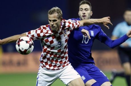 Greece's Kostas Fortounis, right, fights for the ball with Croatia's Ivan Strinic during the World Cup qualifying play-off first leg soccer match between Croatia and Greece at Maksimir Stadium in Zagreb, Thursday Nov. 9, 2017. (AP Photo/Darko Bandic)