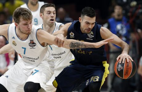 Fenerbahce's Kostas Sloukas dribbles the ball as Real Madrid's Luka Doncic reaches for the ball during their Final Four Euroleague final basketball match between Real Madrid and Fenerbahce in Belgrade, Serbia, Sunday, May 20, 2018. (AP Photo/Darko Vojinovic)