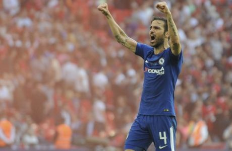 Chelsea's Cesc Fabregas celebrates after winning the English FA Cup final soccer match between Chelsea v Manchester United at Wembley stadium in London, England, Saturday, May 19, 2018. (AP Photo/Rui Vieira)